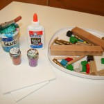 Wood, glitter, and glue constructions