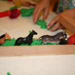 Play dough, animals, and tools