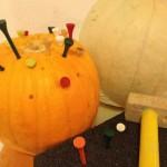 Hammering into pumpkins!