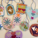 Laminated ornaments and charms