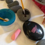 Drawing and brushing water on rocks