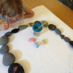 Brushing stones with water