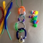 String and wire circle charms