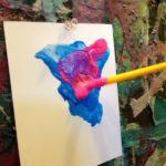 Tempera paint at the easel wall