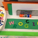 Foam letters, paper, and glue