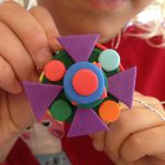 Necklaces with bottle tops and foam shapes
